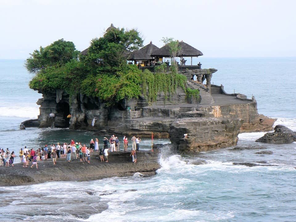 Tanah Lot Temple is built on the rock formation of the sea. It is also well known for its offshore setting and sunset backdrops.
