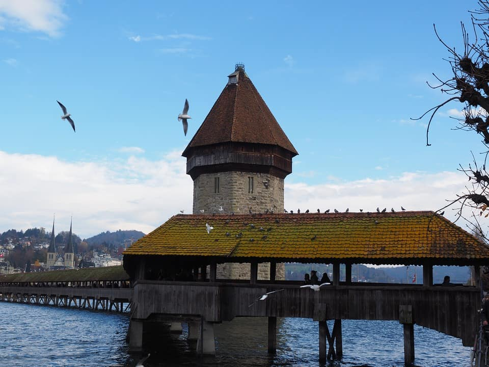 Chapel Bridge is known as Kapellbrücke which is the cover wooden bridge that cross the Reuss river.